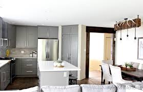 open layout kitchen and dining room cabinets painted benjamin moore amherst gray white quartz