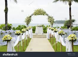wedding set up in garden inside beach #127108628