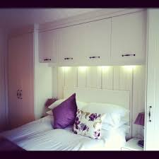 Modern Fitted Bedrooms Wardrobes On Either Side Of The Bed And With Long White Curtains