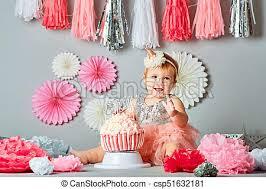 Little Baby Girl Eating Birthday Cake During Cake Smash Party