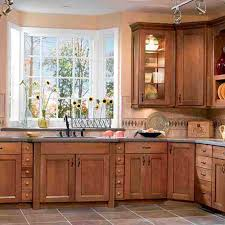 oak lowes kitchen cabinets with cozy tile flooring and transom windows for traditional kitchen design