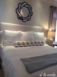 all white bedding 3 beds sofa 10