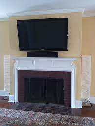 how do you mount a tv above a fireplace on a brick wall without showing unsightly