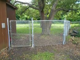 how to build chain link fence diy repair installing on wood posts
