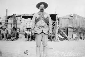 pancho villa  villa wearing bandoliers in front of an insurgent camp undated photo