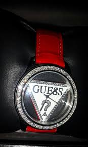 guess watch with interchangeable bands black band is moderately worn white red bands never worn needs new battery bands genuine leather