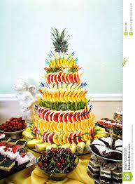 Fruit Pyramid Decoration Cakes And Cookies At Dessert Table At