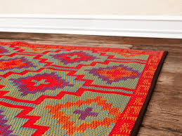 image of unique recycled plastic bottle outdoor rugs design