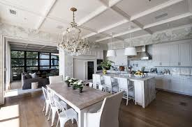 french crystal chandelier over white farmhouse dining table
