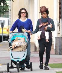 Linda Perry secures son Rhodes in a scarf sling with wife Sara Gilbert in  LA   Daily Mail Online