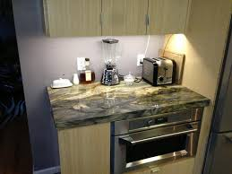 led under cabinet lighting reviews warm white light cream wooden and marble kitchen table