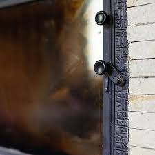 black glass on your fireplace doors
