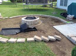 Laying the rumble stone border for fire pit