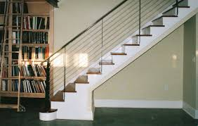 Cool Custom Iron handrails for stairs And Tread With Built In Bookcase Also  Baseboard And Tile