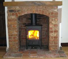 wood burning fireplace scented candle pioneer wood burning stove with brick arch and beam nice stove