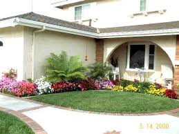 Landscaped Front Yard Of A House With Flowers And Green Lawn Stock ...  Landscaped front yard of a