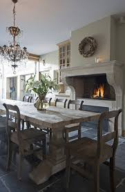 gray wood dining table. Beautiful Dining Room With Crystal Chandelier Over Salvaged Wood Trestle Table Lined Chairs Charcoal Gray Tile Floor. \
