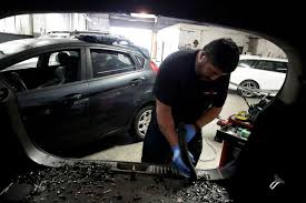 file hector hernandez of auto glass now san francisco vacuums up the broken glass