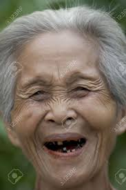 Portrait Of An Old Asian Woman With Gray Hair Stock Photo Picture