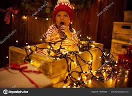 Baby Pics With Christmas Lights Photo Baby With Christmas Lights Child With Cones In