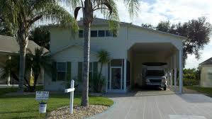houses ranging from modest to decadent the mon denominator is that they all have a garage or car port big enough and high enough to acmodate an rv