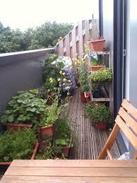 deck vegetable garden house design with hardwood floor tiles and vertical rack storage for garden planter pots ideas