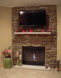 stone fireplace with mounted tv