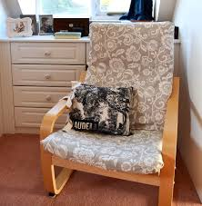 ikea poang chair with new handsewn cover link to awesome tutorial in post and