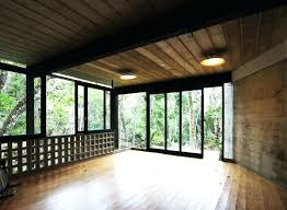 large sliding glass doors and windows open the pavilion to lovely view outside canada