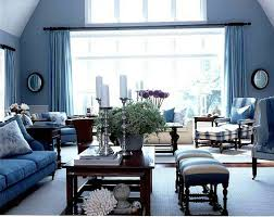 cool stylish blue living room with large clear glass windows blue blue wall curtains and blue