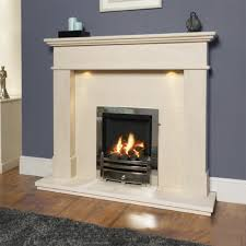 barcelo limestone fireplace with added downlights shown with an inset gas fire finished in chrome with