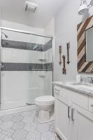 boy bathroom with gray hex shower border tiles