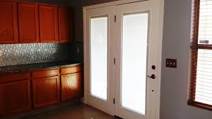 patio doors with blinds inside reviews. kitchen room with double white wooden french door using shade as well fabric roman shades for doors and sliding glass blinds inside. patio inside reviews r