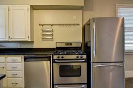 stove and refrigerator. 10 quirky kitchens from the real estate listings hooked on houses - kitchen stove beside dishwasher and refrigerator