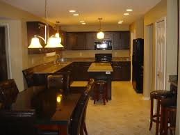 kitchen tile flooring dark cabinets. Cream Wall Room Completed With Dark Brown Wooden Cabinet And Marble Top Place On The Kitchen Tile Flooring Cabinets A