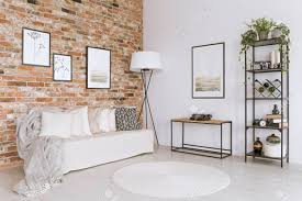 Image Brick Fireplace Stock Photo White Sofa With Pillows And White Carpet In Living Room With Lamp Against Red Brick Wall With Gallery 123rfcom White Sofa With Pillows And White Carpet In Living Room With Stock