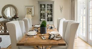 upholstered wingback chairs dining room farmhouse with beige curtains beige wing image by alexander james interiors