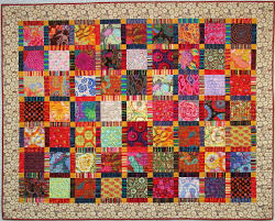 Exuberant Color : Quilts with Kaffe Fassett Fabric & Large squares of Kaffe fabrics with sashing of many striped fabrics, a  Martha Negley fabric border. Adamdwight.com