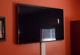 white flat screen tv wall mounts on the orange wall