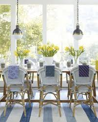 our light pendants give a modern edge to this chic dining room with parisian bistro chairs