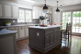 White Kitchen With Gray Island Lined And Black Counter Stools