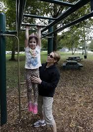 Leslie Shapiro of Easton helps her granddaughter Aurora Shapiro,5 ...