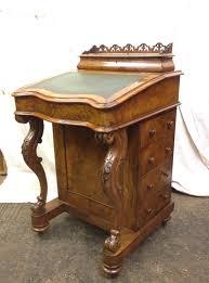 Antique Victorian walnut davenport after restoration