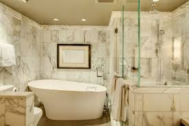 master bathroom with polished marble shower and soaking bathtub