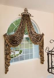wonderful and creative curtain installation with luxurious rubbed bronze  draper rod for arched window