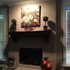 fireplace mantel lighting. the only light source is off center recessed eyeball fireplace mantel lighting i