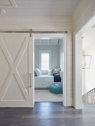 white coastal furniture. this white shiplap barn door opens to reveal a kidsu0027 bedroom filled with built coastal furniture