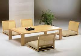 The Zataku dining table is traditional Japanese style dining room furniture  designed by Hara Design. The furniture set comes with Zaisu chairs which  are tr