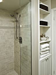 exciting custom linen cabinet with hamper contemporary bathroom shower made with glass tiles and linen