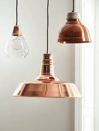 copper lighting fixture. with a stunning glass shade this unique pendant has contrasting copper fitting that shines lighting fixture